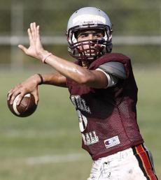 Lowell High quarterback Brian Dolan threw during practice as the team prepared for the upcoming season.
